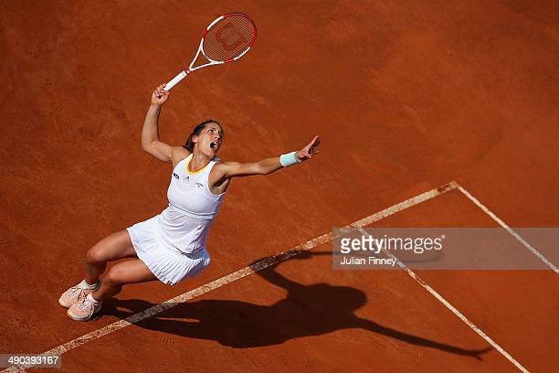 Andrea Petkovic of Germany serves in her match against Serena Williams of USA during day four of the Internazionali BNL d'Italia tennis 2014 on May...