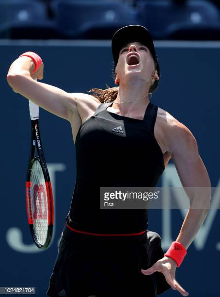 Andrea Petkovic of Germany serves the ball during her women's singles first round match against Jelena Ostapenko of Latvia on Day Two of the 2018 US...