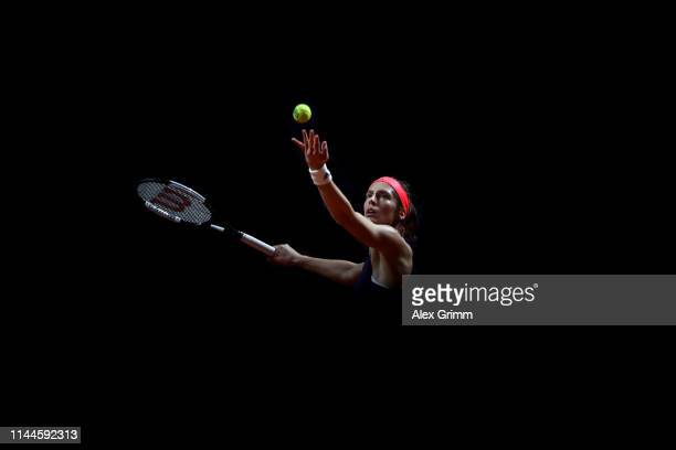 Andrea Petkovic of Germany serves the ball to Sara Sorribes Tormo of Spain during their first round match on day 2 of the Porsche Tennis Grand Prix...