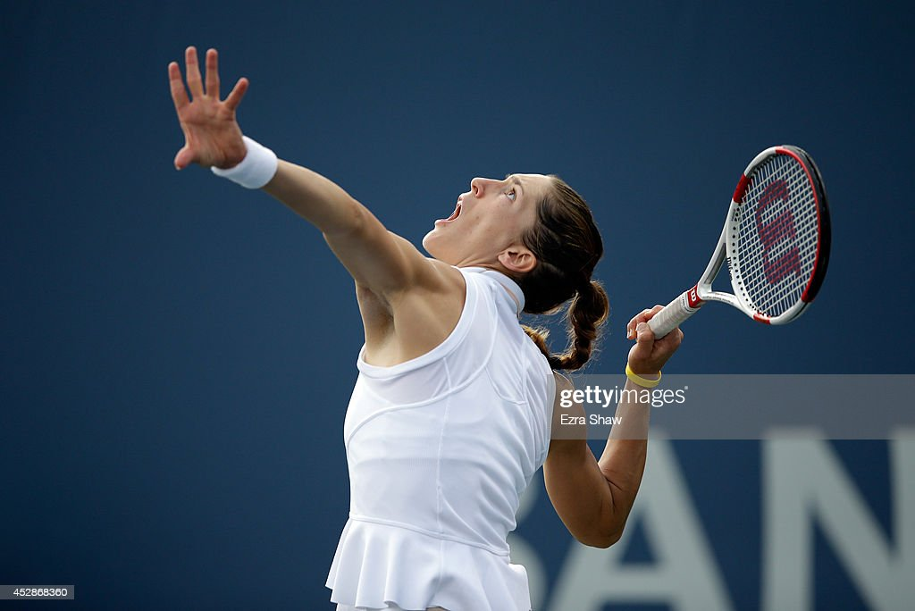Andrea Petkovic of Germany serves to Ajla Tomljanovic of Crotia during Day 1 of the Bank of the West Classic at the Taube Family Tennis Stadium on July 28, 2014 in Stanford, California.