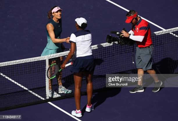 Andrea Petkovic of Germany shakes hands at the net after her three set defeat against Venus Williams of the United States during their womens singles...