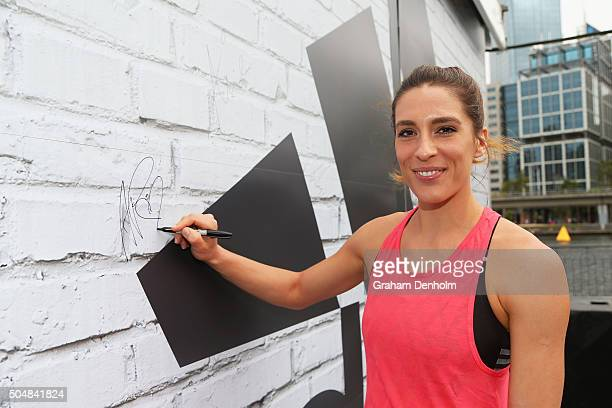 Andrea Petkovic of Germany signs her autograph during the adidas ACE Case Launch at Crown Entertainment Complex on January 14 2016 in Melbourne...