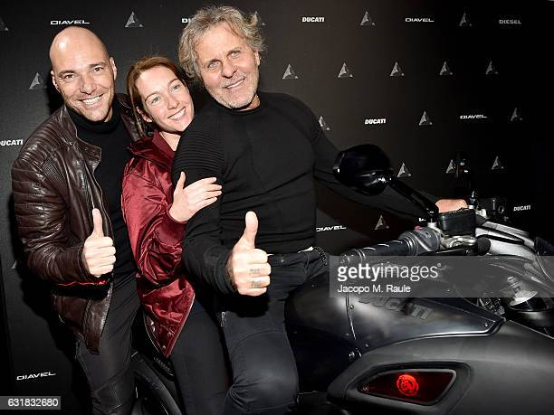 Andrea Pezzi Cristiana Capotondi and Renzo Rosso attend DDD Ducati Diavel Diesel presentation during Milan Men's Fashion Week Fall/Winter 2017/18 on...