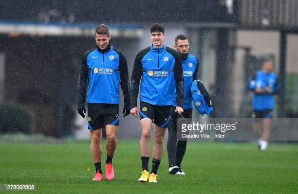 Andrea Pinamonti, Alessandro Bastoni and Stefano De Vrij walk on the pitduring an FC Internazionale training session at Appiano Gentile on October...