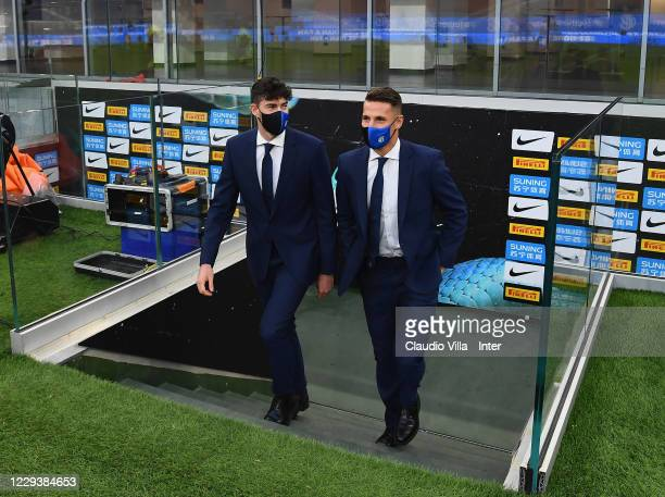 Andrea Pinamonti and Alessandro Bastoni of FC Internazionale look on before the Serie A match between FC Internazionale and Parma Calcio at Stadio...