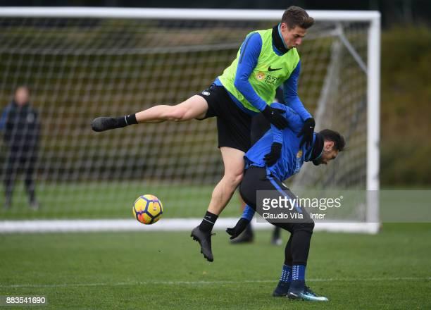 Andrea Pinamonti and Danilo D'Ambrosio of FC Internazionale compete for the ball during the FC Internazionale training session at Suning Training...