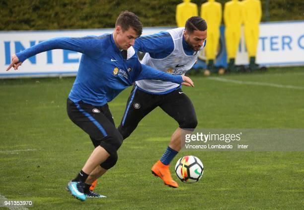 Andrea Pinamonti and Danilo D'Ambrosio of FC Internazionale in action during the FC Internazionale training session at Appiano Gentile on April 3...