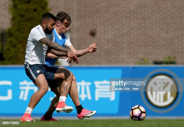 Andrea Pinamonti and Gabriel Barbosa Almeida compete for the ball during FC Internazionale training session at Suning Training Center at Appiano...