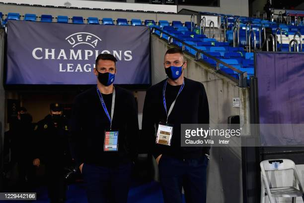 Andrea Pinamonti and Milan Skriniar of FC Internazionale arrive prior to the UEFA Champions League Group B stage match between Real Madrid and FC...