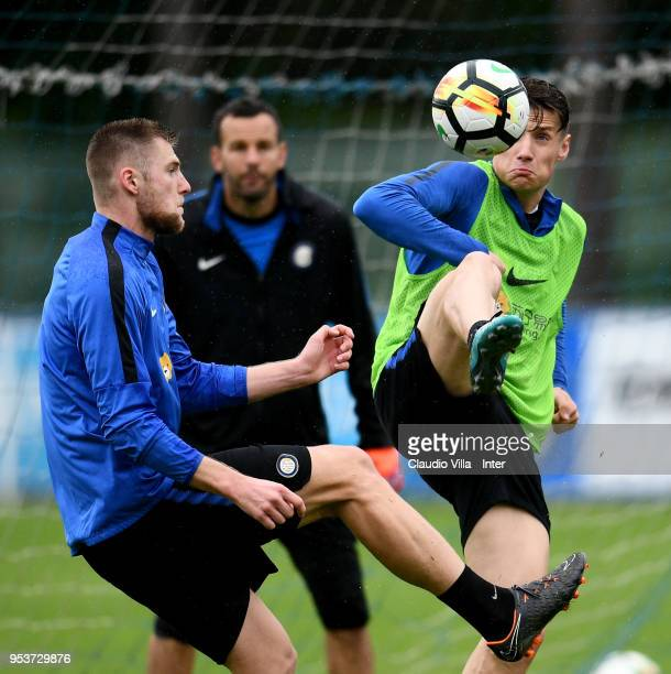Andrea Pinamonti and Milan Skriniar of FC Internazionale compete for the ball during the FC Internazionale training session at the club's training...