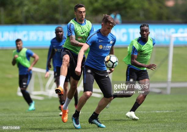 Andrea Pinamonti is challenged by Matias Vecino during the FC Internazionale training session at the club's training ground Suning Training Center in...