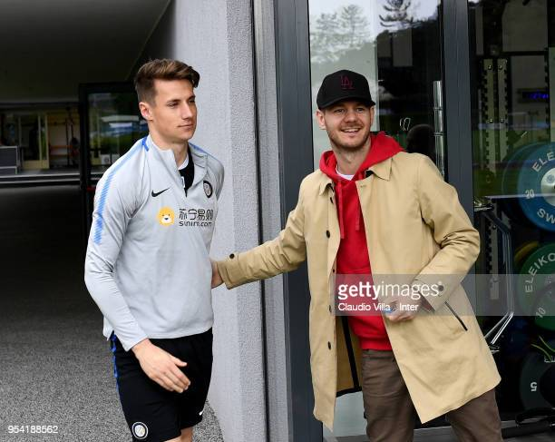 Andrea Pinamonti of FC Internazionale and Alessandro Cattelan pose for a photo during the FC Internazionale training session at the club's training...