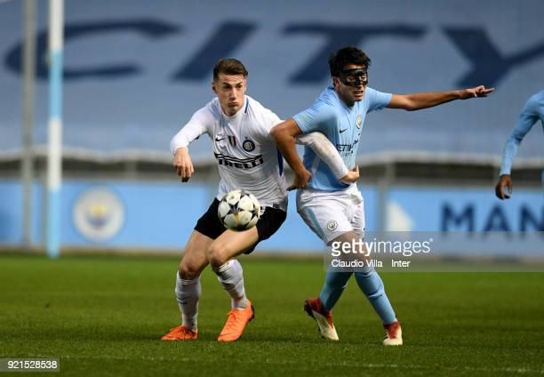 Andrea Pinamonti of FC Internazionale and Eric Garcia of Manchester City compete for the ball during the UEFA Youth League match between Manchester...