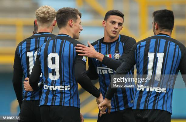 Andrea Pinamonti of FC Internazionale celebrates with his teammates Gabriele Zappa and Matteo Rover after scoring the opening goal during the Serie A...