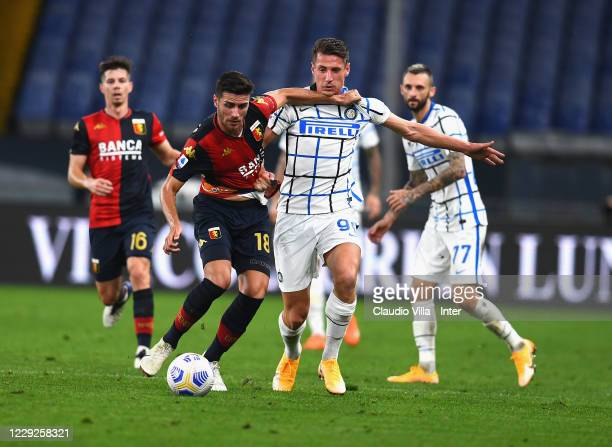 Andrea Pinamonti of FC Internazionale competes for the ball with Paolo Ghiglione of Genoa CFC during the Serie A match between Genoa CFC and FC...