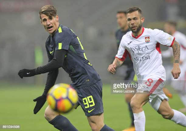 Andrea Pinamonti of FC Internazionale competes for the ball with Salvatore Burrai of Pordenone during the TIM Cup match between FC Internazionale and...
