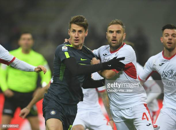 Andrea Pinamonti of FC Internazionale competes for the ball with Mirko Stefani of Pordenone during the TIM Cup match between FC Internazionale and...