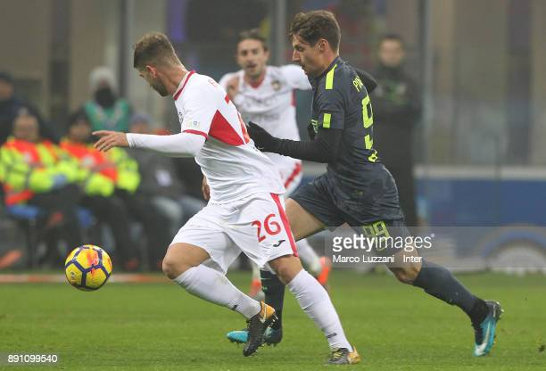 Andrea Pinamonti of FC Internazionale competes for the ball with Alessandro Bassoli of Pordenone during the TIM Cup match between FC Internazionale...