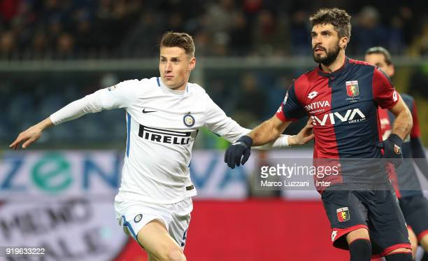 Andrea Pinamonti of FC Internazionale competes with Luca Rossettini of Genoa CFC during the serie A match between Genoa CFC and FC Internazionale at...