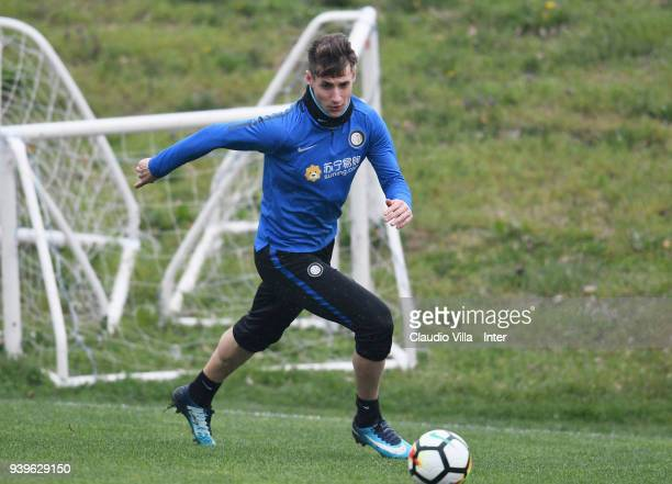 Andrea Pinamonti of FC Internazionale in action during the FC Internazionale training session at the Angelo Moratti Sports Centreer in memory of...