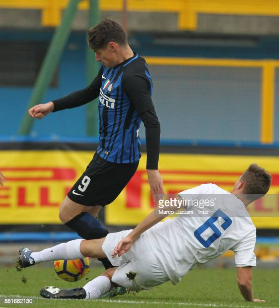 Andrea Pinamonti of FC Internazionale is challenged during the Serie A Primavera match between FC Internazionale U19 and Novara Calcio U19 at Stadio...