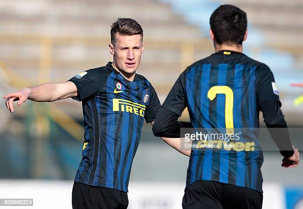 Andrea Pinamonti of FC Internazionale Milano speaks with his teammate Matteo Rover during the Primavera Tim Cup juvenile match between FC...
