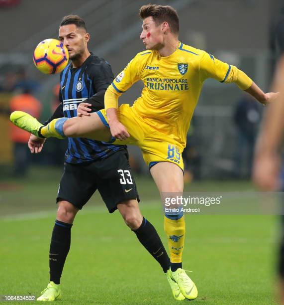 Andrea Pinamonti of Frosinone Calcio competes for the ball with Danilo D Ambrosio of FC Internazionale during the Serie A match between FC...