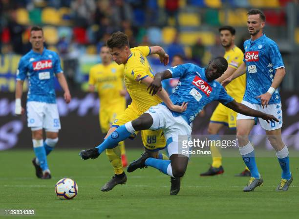 Andrea Pinamonti of Frosinone Calcio competes for the ball with Kalidou Koulibaly of SSC Napoli during the Serie A match between Frosinone Calcio and...