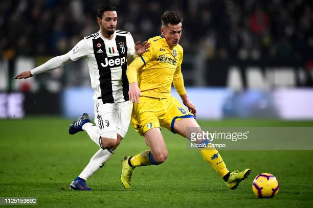 Andrea Pinamonti of Frosinone Calcio is challenged by Mattia De Sciglio of Juventus FC during the Serie A football match between Juventus FC and...