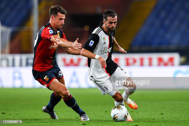 Andrea Pinamonti of Genoa and Miralem Pjanic of Juventus vie for the ball during the Serie A match between Genoa CFC and Juventus FC at Stadio Luigi...