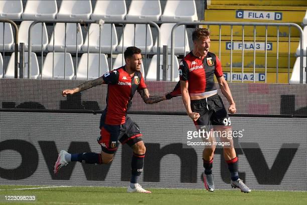 Andrea Pinamonti of Genoa celebrates with Toni Sanabria of Genoa during the Italian Serie A match between Brescia v Genoa at the Stadio Mario...