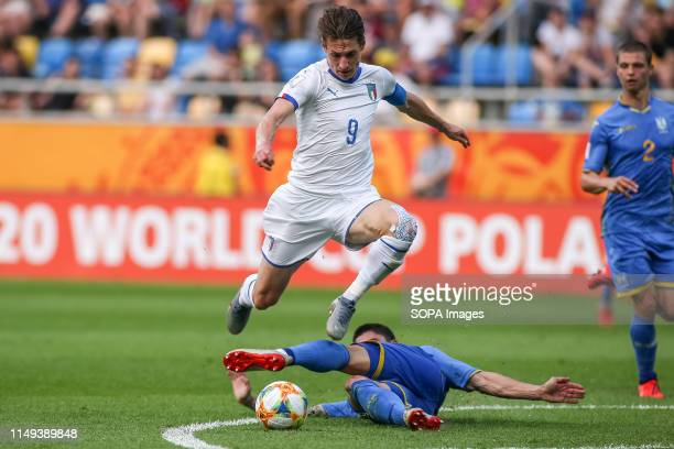 Andrea Pinamonti of Italy and Denys Popov of Ukraine are seen in action during the FIFA U-20 World Cup match between Ukraine and Italy in Gdynia. .