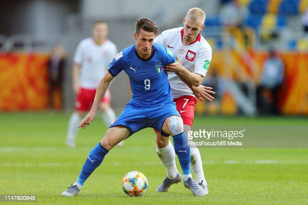 Andrea Pinamonti of Italy and Tomasz Makowski of Poland compete for the ball during the FIFA U20 World Cup Round of 16 match between Italy and Poland...