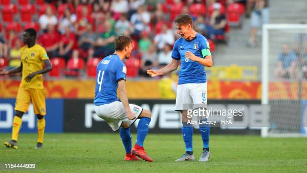 Andrea Pinamonti of Italy celebrates with team mate Matteo Gabbia of Italy after scoring their team's second goal following a VAR check during the...