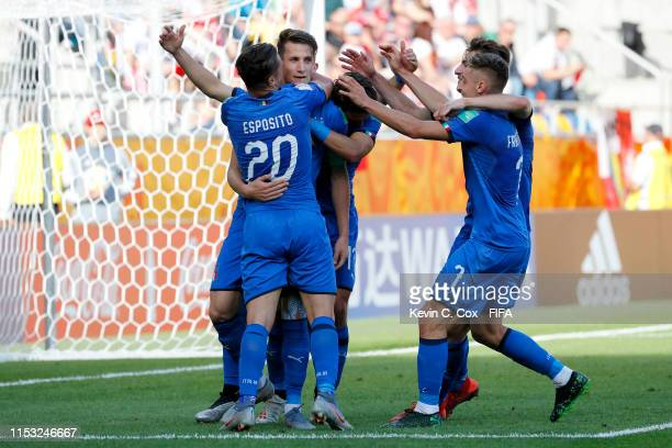 Andrea Pinamonti of Italy celebrates with teammates after scoring his team's first goal during the 2019 FIFA U20 World Cup Round of 16 match between...