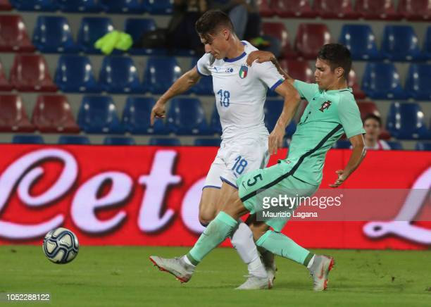 Andrea Pinamonti of Italy competes for the ball with Moura of Portugal during the match beteween Italy U20 v Portugal U20 on October 16 2018 in...