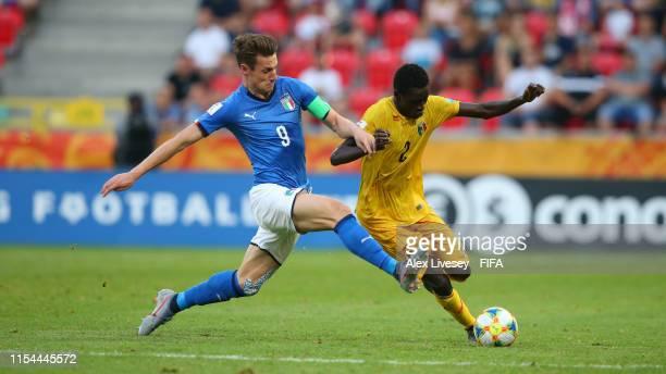 Andrea Pinamonti of Italy tackles Arnaud Konan of Mali during the 2019 FIFA U-20 World Cup Quarter Final match between Italy and Mali at Tychy...