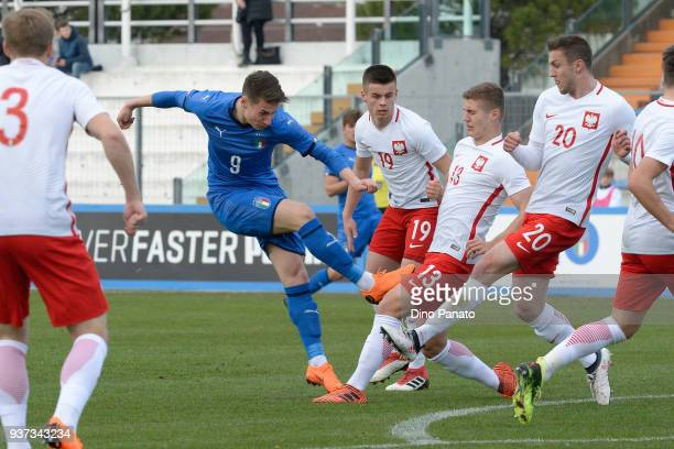 Andrea Pinamonti of Italy U19 competes with Radoslaw Kanach of Poland U19 during the Elite Round U19 match between Italy and Poland on March 24 2018...
