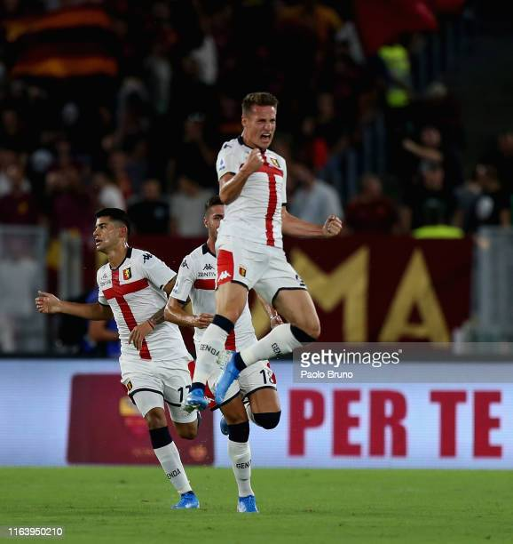 Andrea Pinamonti with his teammates of Genoa CFC celebrates after scoring the team's first goal during the Serie A match between AS Roma and Genoa...