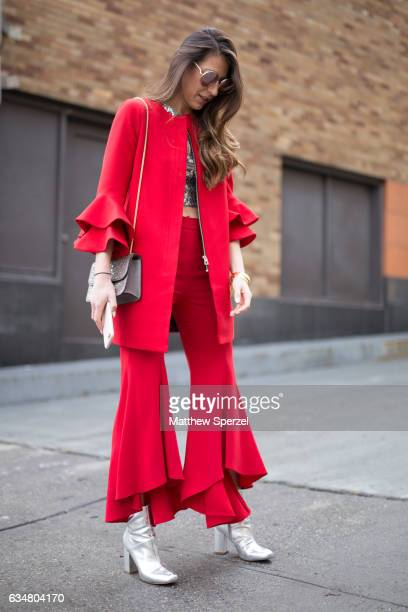 Andrea Pion is seen attending Taoray Wang/Creatures of the Wind during New York Fashion Week wearing a Zara outfit with Urban Outfitters bootsÊand...