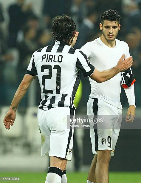 Andrea Pirlo and Alvaro Morata of Juventus FC celebrate a victory at the end of the UEFA Champions League semi final match between Juventus and Real...