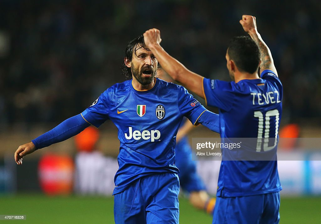 Andrea Pirlo (L) and Carlos Tevez of Juventus celebrate at the final whistle during the UEFA Champions League quarter-final second leg match between AS Monaco FC and Juventus at Stade Louis II on April 22, 2015 in Monaco, Monaco.