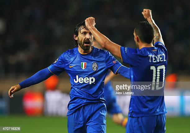 Andrea Pirlo and Carlos Tevez of Juventus celebrate at the final whistle during the UEFA Champions League quarterfinal second leg match between AS...