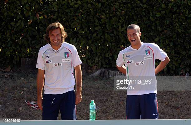 Andrea Pirlo and Sebastian Giovinco of Italy laugh during an Italy training session ahead of the UEFA Euro 2012 Group C qualifier against Serbia at...