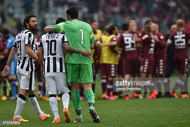 Andrea Pirlo Carlos Tevez and Gianluigi Buffon of Juventus FC show their dejection at the end of the Serie A match between Torino FC and Juventus FC...