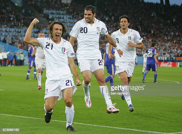 Andrea Pirlo celebrates scoring a penalty for Italy with Simone Perrotta and Luca Toni during the Group C UEFA EURO 2008 match between France and...