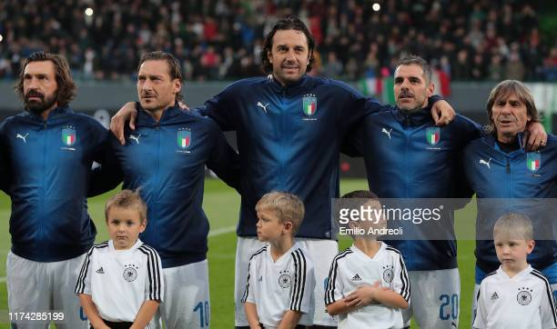 Andrea Pirlo Francesco Totti Luca Toni Simone Perrotta and Bruno Conti of Azzurri Legends line up for the anthem prior to the friendly match between...