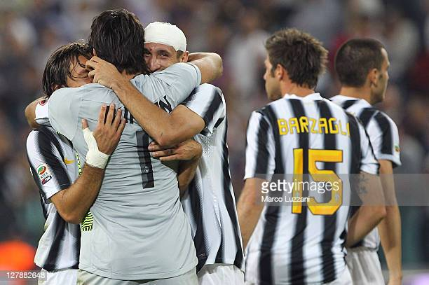 Andrea Pirlo Gianluigi Buffon and Giorgio Chiellini of Juventus FC celebrates a victory at the end the Serie A match between Juventus FC and AC Milan...
