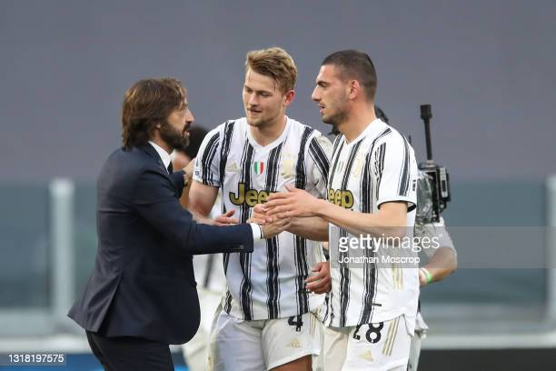 Andrea Pirlo Head coach of Juventus congratualtes Matthijs De Ligt and Merih Demiral as the club's Champions League qualification remains alive...