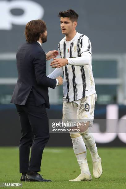 Andrea Pirlo Head coach of Juventus congratulates Alvaro Morata of Juventus as the club's Champions League qualification remains alive following the...